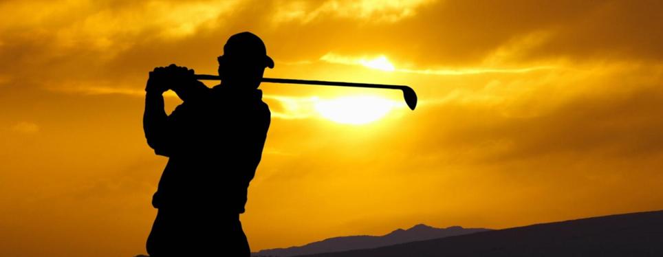 golfer-swinging-sunset